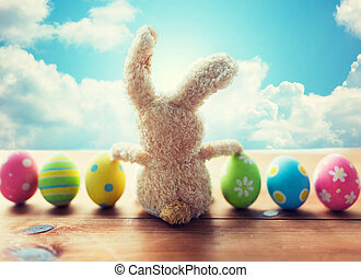 close up of colored easter eggs and bunny