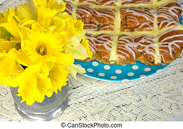 Easter hot cross buns with daffodil bouquet