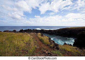 Easter Island rocky coast line under blue sky