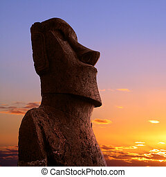 Easter island - A stone statue on Easter island at sunset