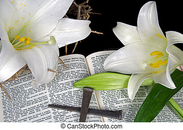 Easter lilies and nails on Holy Bible.