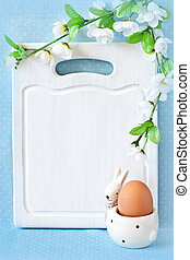 Easter menu. - Old white kitchen cutting board with...