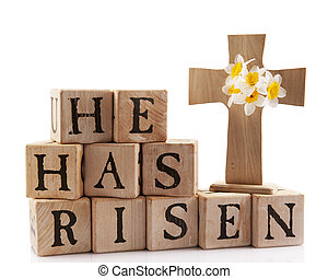 "Easter Message - A wooden cross with the words ""He has..."