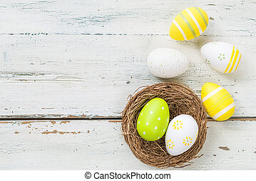 Easter nest with easter eggs on a wooden background