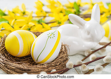 Easter nest with yellow easter eggs on a rustic background