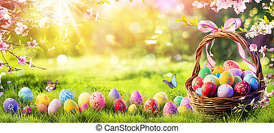 Easter Painted Eggs In Basket On Grass In Sunny Orchard