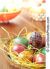 Easter painted eggs on traditional seasonal table - Easter...