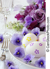 Easter place setting with spring purple flowers