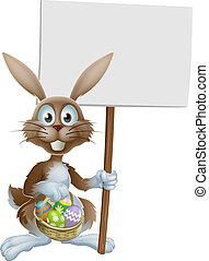 Easter rabbit with sign and eggs