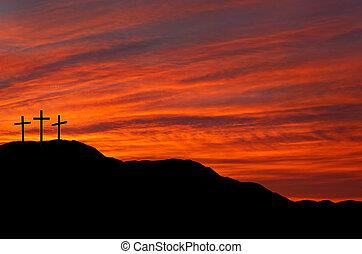 Three crosses against red sky