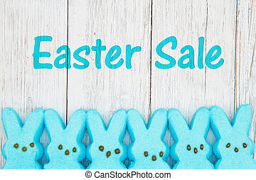Easter sale message with blue candy bunnies