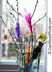 Easter still life, willow branch and feathers in a vase