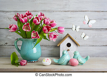 Easter still life with eggs and tulips