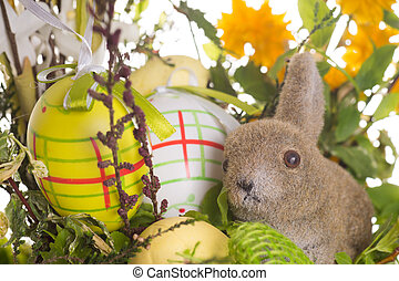 Easter eggs and Easter bunny with flowers
