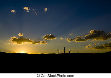 Sun rising on three Christian crosses.