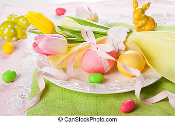 Easter table setting with tulips and easter eggs