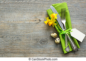 Easter table setting with daffodil and cutlery. Holidays...