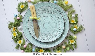 Easter table setting with flowers and eggs. Empty decorative...