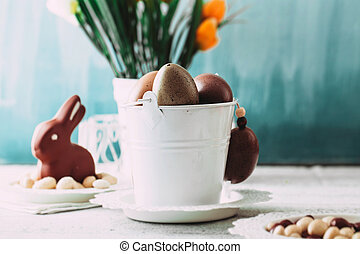 Easter table - Easter. Chocolate Eggs and bunny on Easter...