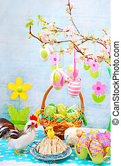 easter table with colorful eggs decoration