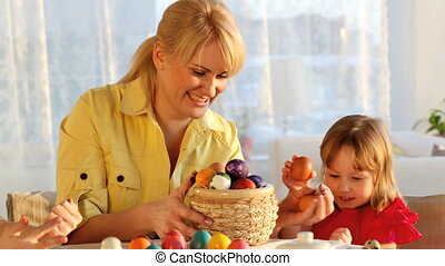 Easter tradition - Mom and daughters celebrating Easter by...