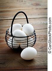Whitel easter eggs in black wire basket