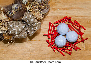 Easter wreath and golf balls on the wooden table