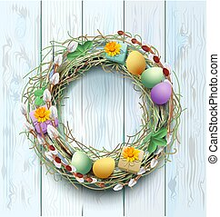 Easter wreath decoration. Branch of willow and colored eggs