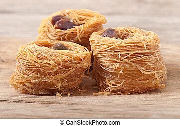 Eastern dessert baklawa with pistachio nuts, dessert sweets assorted