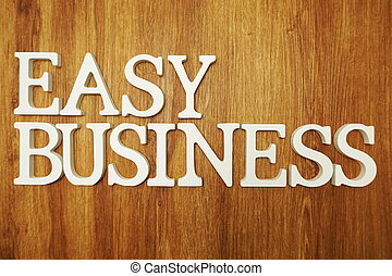 Easy Business word alphabet letters on wooden background