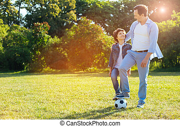 Easy going loving parent spending time with his kid