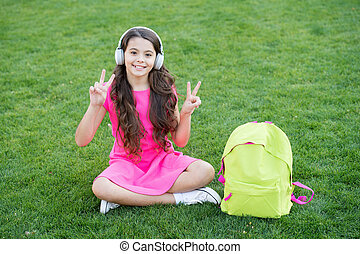 Easy listening and study. Happy girl enjoy listening to music. Small child practise listening skills. Listening course. Distance learning. School and education. Modern life. On peaceful waves