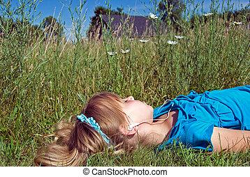 Easy Listening - Little girl in meadow listening to music.