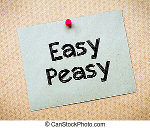 Easy Peasy Message. Recycled paper note pinned on cork...