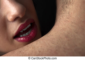 Easy Prey - Detail shot of vampiric female lips about to bit...