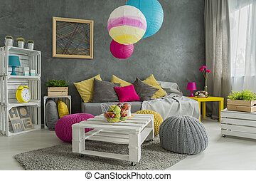 Easy room makeover- paper lamps, wool poufs and pillows