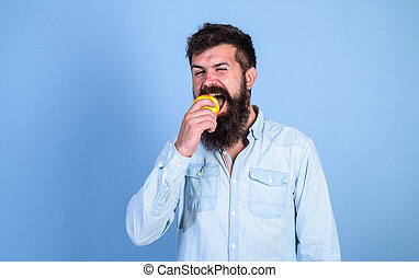 Eat apple can help lower blood sugar levels and protect against diabetes. Apples popular fruit in world. Eat healthy. Man with beard hipster hold apple fruit hand. Nutrition facts and health benefits