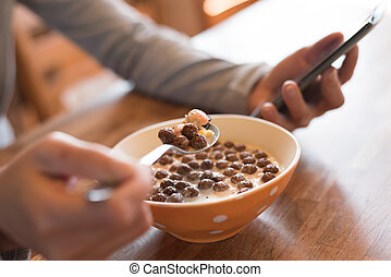 eat cereal with phone