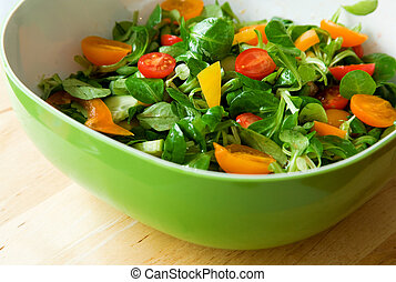 Eat healthy! Fresh vegetable salad served in a green salad bowl