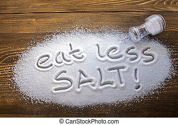 Eat less salt – medical concept - Eat less salt written on a...