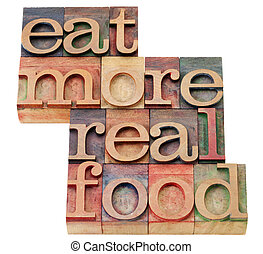 eat more real food - healthy lifestyle concept - isolated text in vintage wood letterpress printing blocks