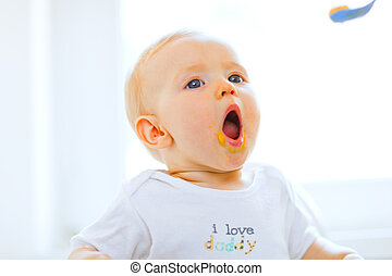 Eat smeared lovely baby open mouth for spoon - Eat smeared...