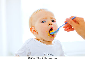 Eat smeared pretty baby open mouth for spoon - Eat smeared...