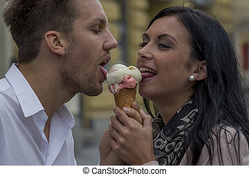 eat some ice cream at - a young couple with a bag of ice....