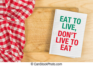 Eat To Live, Don't Live To Eat message on Kitchen Table
