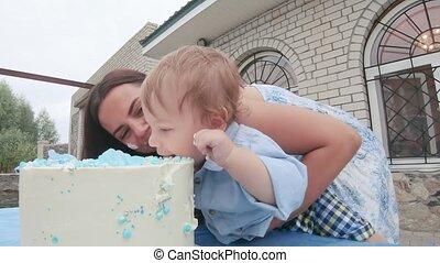 Eating a birthday cake