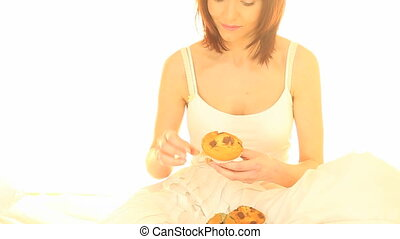 Eating A Muffin In Bed