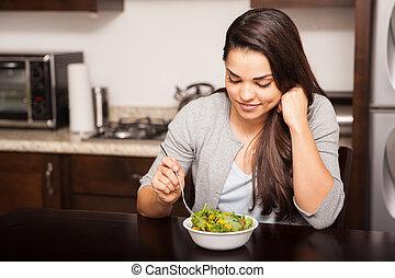Eating a salad at home