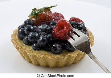 eating a tart with mixed berries