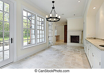 Eating area in new construction home with fireplace